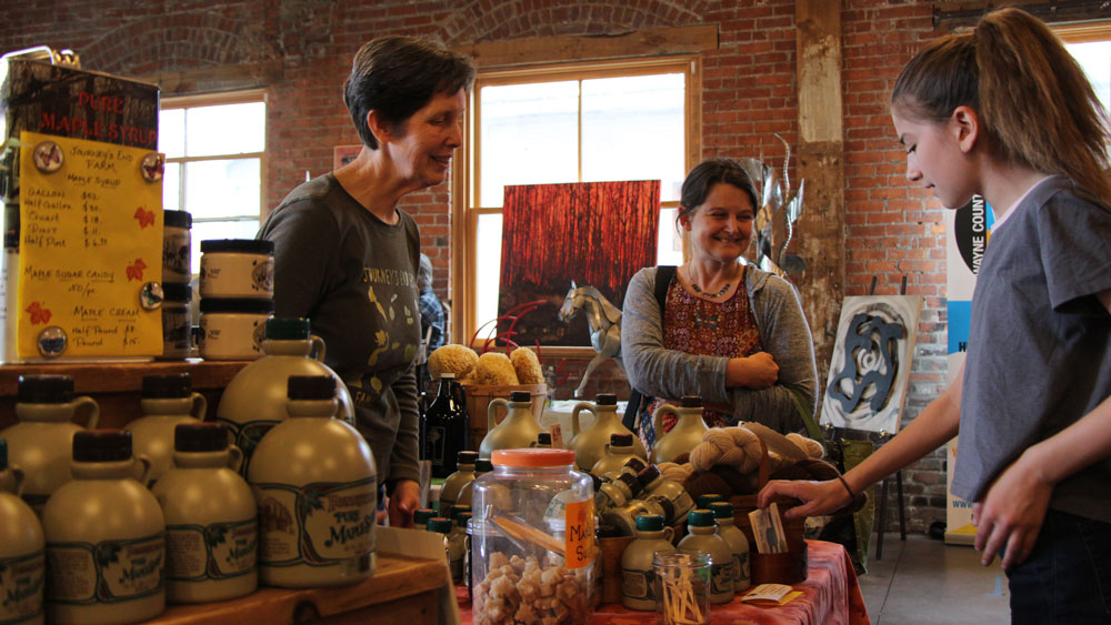 women at a farmers market