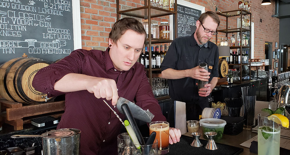 bartenders making cocktails